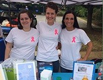 Team members at breast cancer event